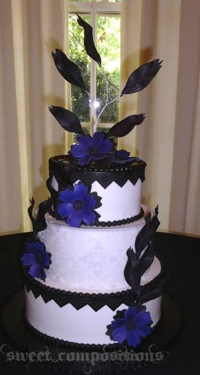Bold and beautiful purple blossoms make this wedding cake pop.