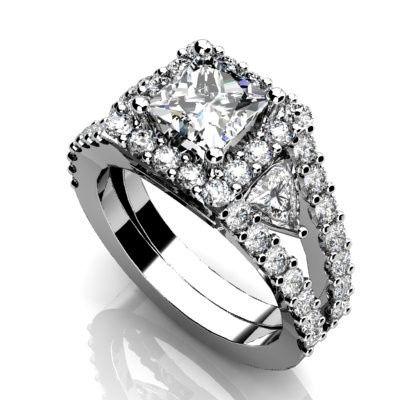 Custom white gold or platinum diamond engagement ring.  Diamond halo with split shank and trillion...