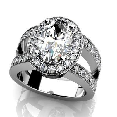Custom white gold or platinum diamond engagement ring.  Oval center diamond with diamond halo, split...