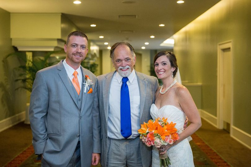 Officiant with the newlywed couple