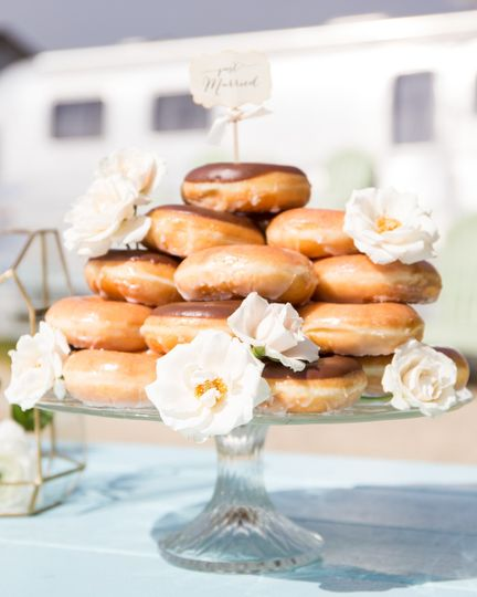 This couple decided to go with a unique donut cake which is included as part of one of the...