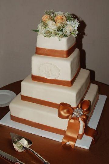 Elegant White Wedding Cake wrapped with Bronze Ribbon & Rhinestone Accented Bow
