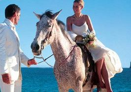 Arrive at your beach wedding on horseback, and even have your ceremony on horseback, too! Follow...