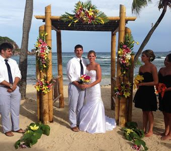 Bride and groom under the beautifully decorated arch at Bolongo Bay, St. Thomas.