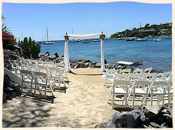 Arch and chairs set up for a destination wedding at Elysian Beach.