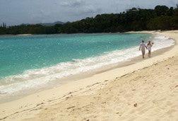 A stroll on the beach after their wedding at Lindquist Beach, St. Thomas.