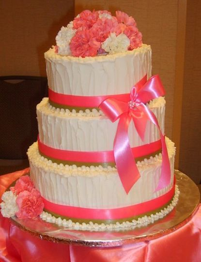 3-tier cake with pink ribbons