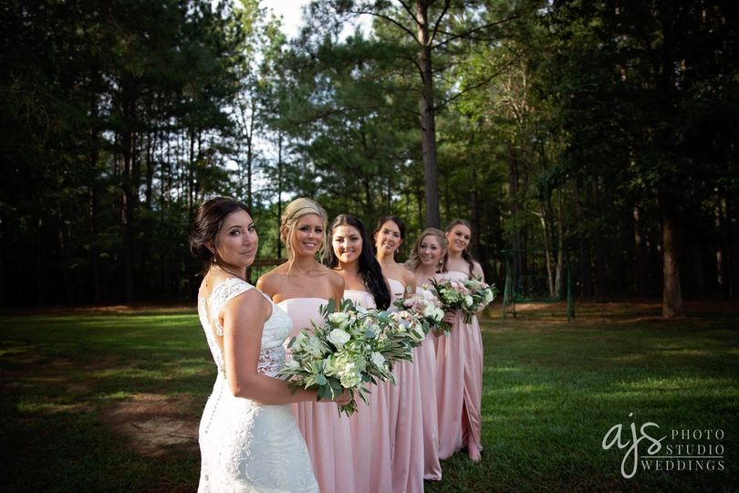 Bride and bridesmaids by the woods