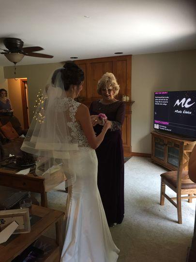 Sabrina preparing her future mother in law just before her wedding begins.