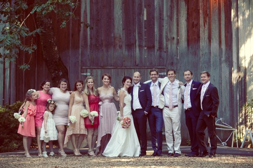 Wedding party in front of the Octagonal Barn