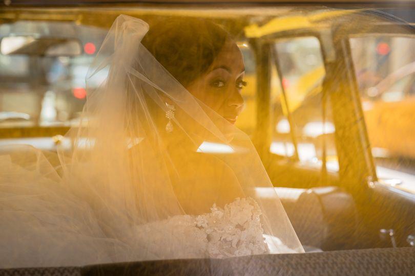 Elegant wedding portrait in car