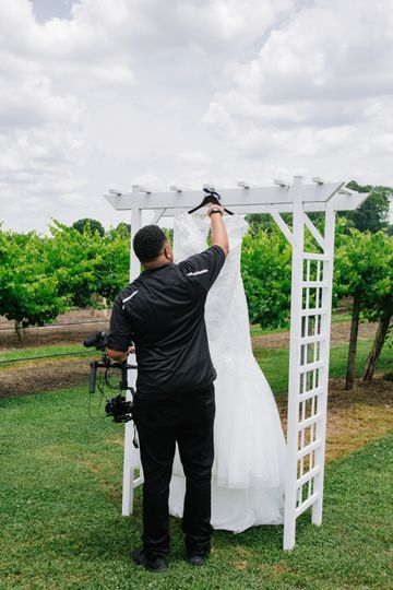 Setting up for a shot of the dress