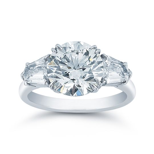 Three carat triple excellent round diamond with tapered bullet side stones in hand made platinum...