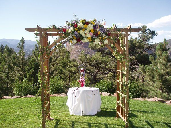 Our rental lattice arch is 7' tall, 6' wide, and 4' deep.  It creates a beautiful setting for you,...
