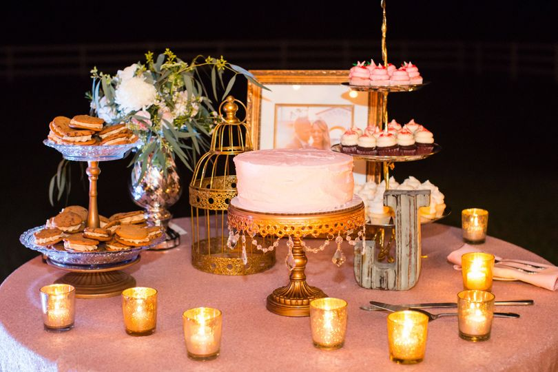 Cakes, cupcakes, and cookies make this dessert table elegantly delicious.
