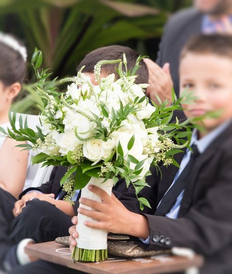 Kid holding bouquet
