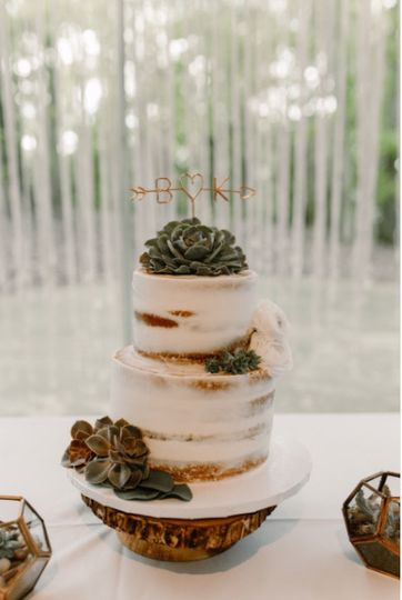 Naked wedding cake with green decors