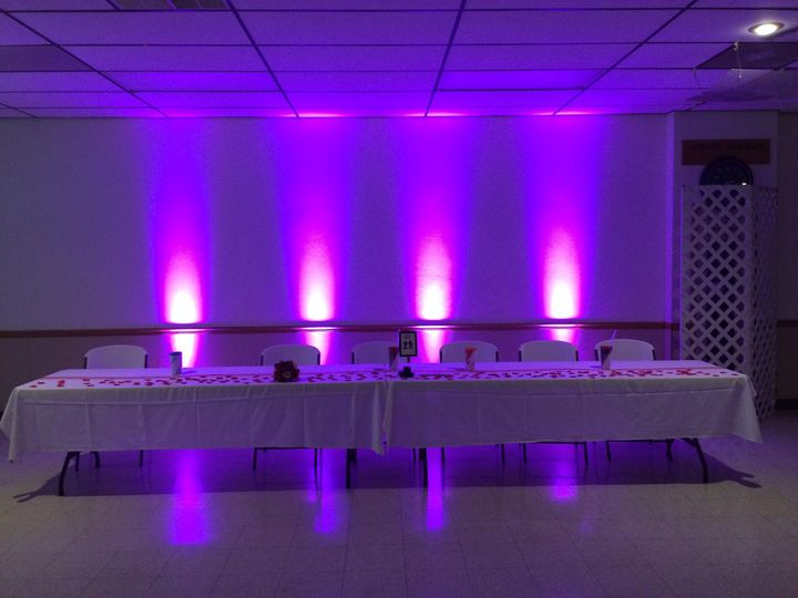 Wedding Party table with pink up lights