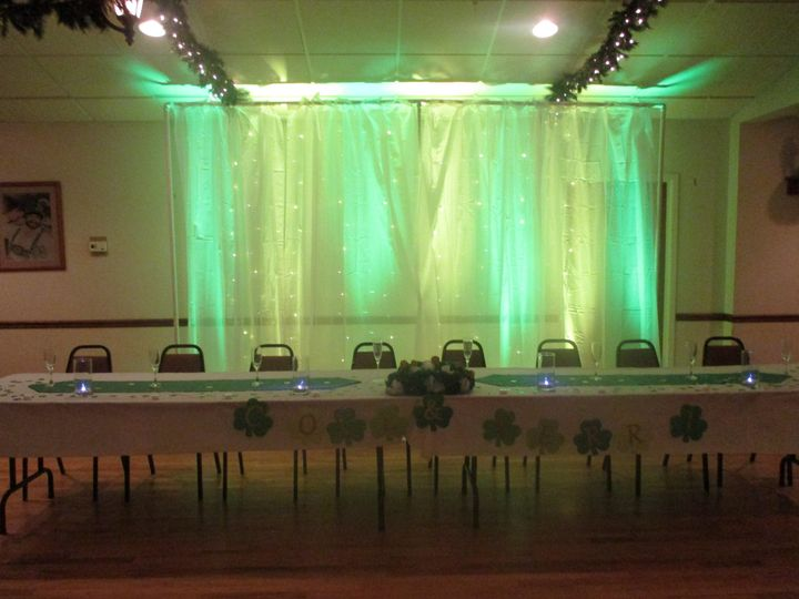 Wedding Party table with green and yellow up lights