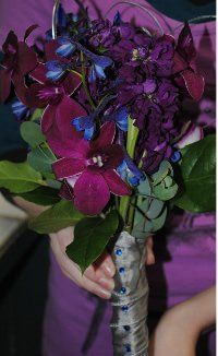 Purple dendrobium orchid, stock and blue delphinium bridesmaids bouquet