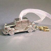 Dimensional silvertone wedding car with goldtone can charms. Can be customized with engraving on the...