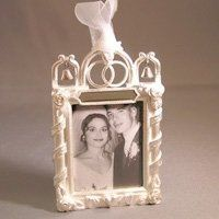 Matte silver small wedding frame with double rings and bell.  Customize with engraving on top for a...