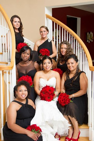 Bride and bridesmaids on a staircase