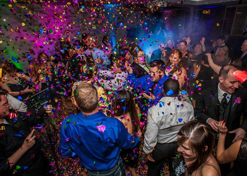 Guests dancing with confetti