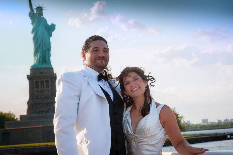 In front of the Statue of Liberty - Kerwin Capers Studios