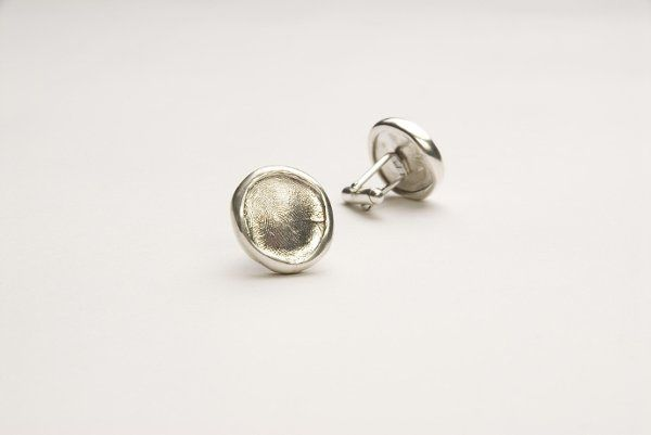 Sterling silver cuff links with silver bezel