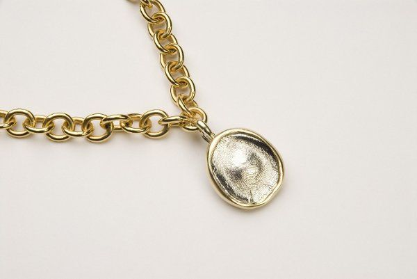 Sterling silver pendant with 18kt gold bezel shown on signature toggle chain