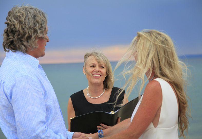 Officiant happy for the newlyweds