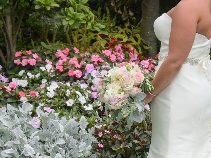 Tmx Bride Alone With Bouquet Against Garden Flowers 51 127236 158887028140018 Sutton, MA wedding venue