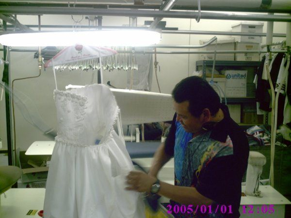 checking the dress for any corrections or spots that we need to work on.