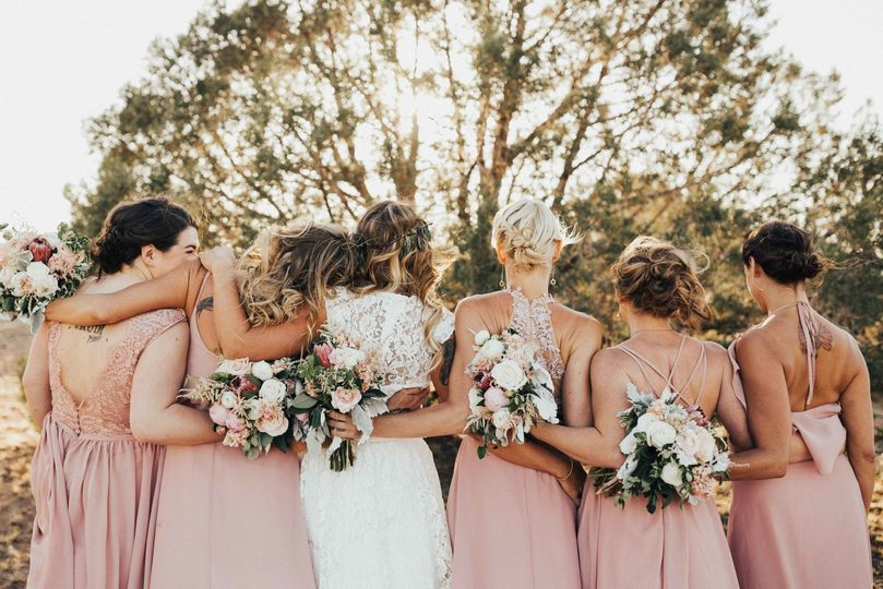 Bride and bridesmaids turned back