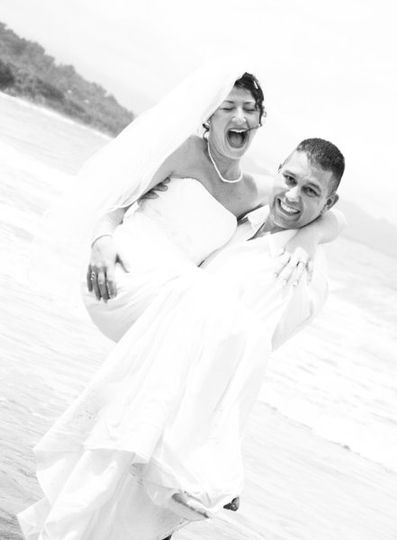 9601a53eaa49 Bride and her groom are all smiles just minutes after their beach wedding  ceremony in Costa