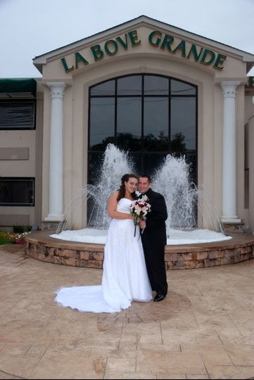 Bride and groom in front of LaBove Grande fountain.