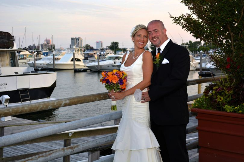 Bride and groom with Atlantic City marina in the background.