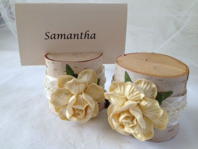 Beautiful french vanilla cream roses with ivory and pearl satin ribbon make these place card holders...