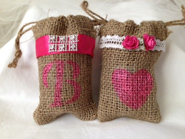 Perfectly rustic! These customized burlap bags have two functions! Not only do they hold your guests...