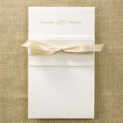Simple, clean invite with gold ribbon