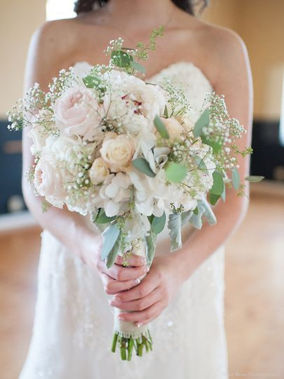 Bridal Bouquet featuring pink, blush, and ivory toned flowers. Very large ivory Hydrangeas were...