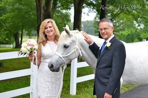 The newlyweds and a horse