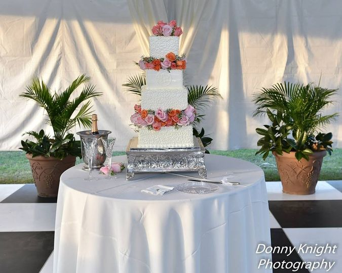 Large four tier cake, with fresh two fresh flower tiers.