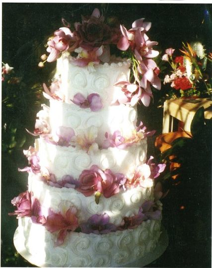 five tier buttercream cake with fresh flowers ,feeds approx 280