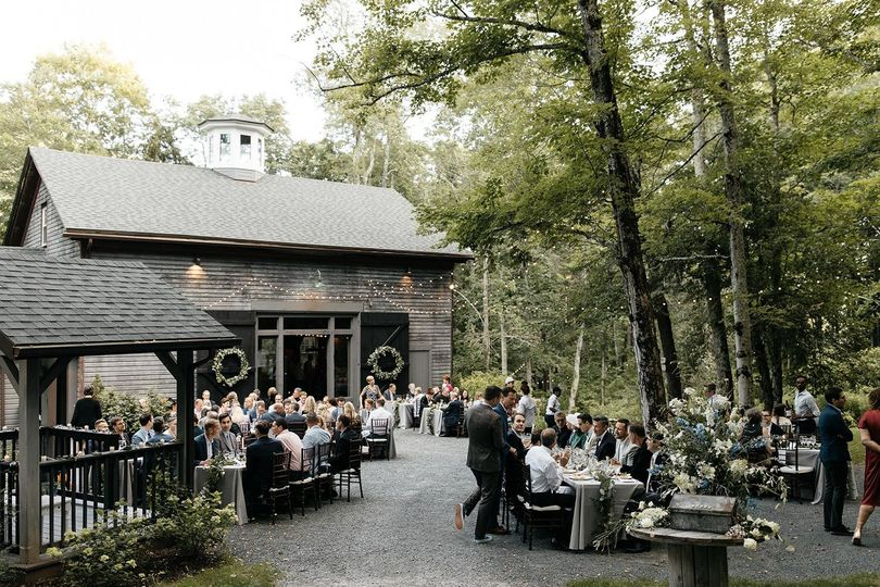 Dinner reception on the courtyard in front of the 1851 carriage barn at The Roxbury Barn & Estate....