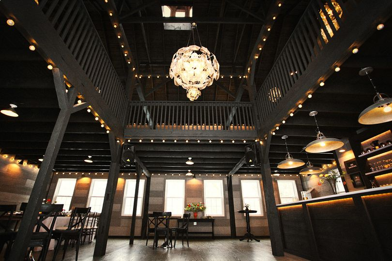 The two event spaces inside the 1851 carriage barn at The Roxbury Barn & Estate.