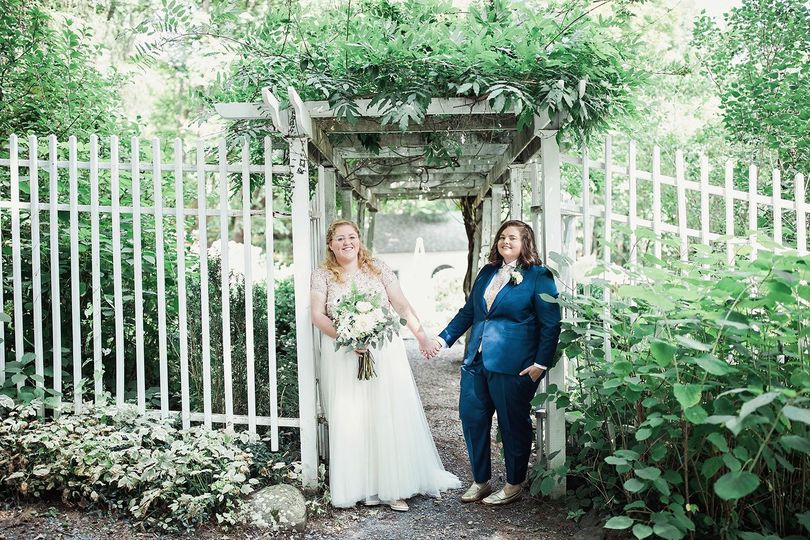 Two brides at the entrance to the Secret Garden at The Roxbury Barn & Estate. Photo by Clean Plate...