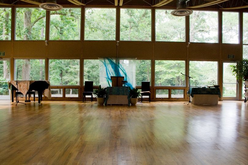 Sanctuary with beautiful floor to ceiling windows that overlook the woods.