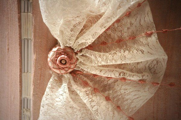 This book is wrapped in rose dust dupioni silk with a tonalistic button and pearls (tone on tone) to...